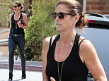 EXCLUSIVE: Cindy Crawford walking back to her car dressed all in black after a meeting in Malibu.  Pictured: Cindy Crawford Ref: SPL1006523  220415   EXCLUSIVE Picture by: Brewer / Brooks / Splash News  Splash News and Pictures Los Angeles: 310-821-2666 New York: 212-619-2666 London: 870-934-2666 photodesk@splashnews.com