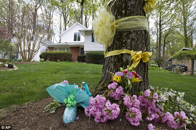 Flowers and ribbons adorn a tree outside the Weinstein family house in Rockville, Maryland