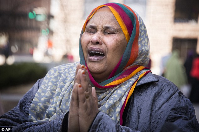 'They came here for peace': Halima Yusuf, a friend of the family of one of the suspects Hanad Mustafe Musse,  cries for the boys outside the United States Courthouse in St Paul, Minnesota