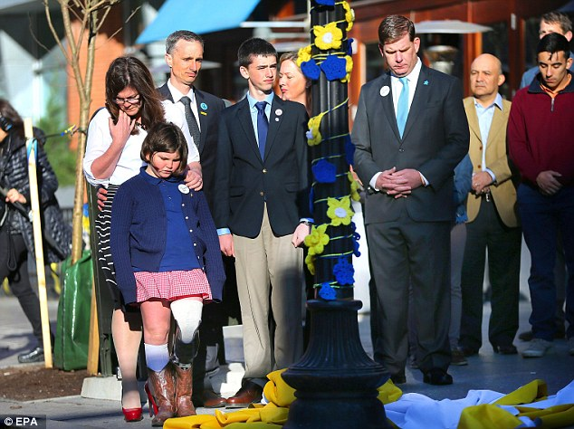 The Richard's family unveil a banner during the two-year anniversary of the Boston Marathon bombings. Eight-year-old Martin Richard died in the attack while his sister Jane (front left) lost her leg