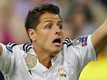 Lucia Villalon, Javier Hernandez Chicharito's girlfriend and Daniela Ospina, James Rodriguez's wife and daughter, League Quarter FInals Real Madrid vs Atletico de Madrid  Pictured: Javier Hernandez, Chicharito Ref: SPL1006731  220415   Picture by: Splash News  Splash News and Pictures Los Angeles: 310-821-2666 New York: 212-619-2666 London: 870-934-2666 photodesk@splashnews.com