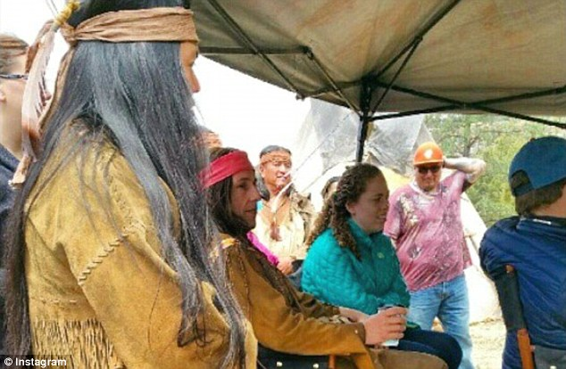 A dozen Native American extras and the cultural adviser walked off the set of Adam Sandler's (seated above in wig) new movie The Ridiculous 6 on Wednesday