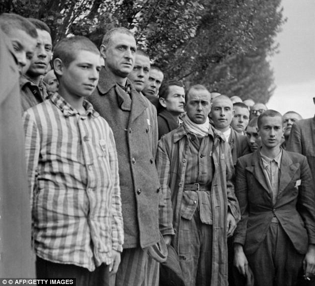 Survivors: French prisoners pictured when the Nazi concentration camp of Dachau, near Munich, was liberated by Allied troops at the end of April 1945. Many of the Nazi guards got away with their crimes by claiming they were just following orders
