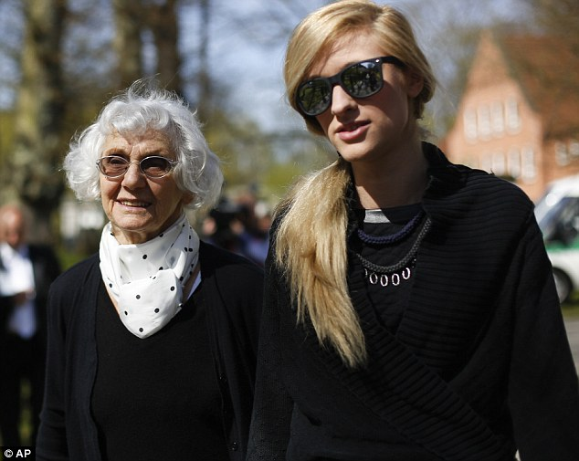 Trial: People like Auschwitz survivor Eva Pusztai-Fahidi, left, from Budapest and her 23-years-old granddaughter Luca Hartai, have traveled from all over the world to witness one of the few prosecutions held