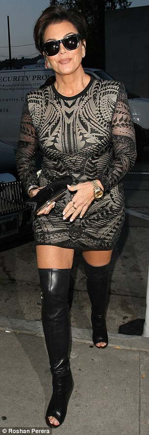 Night on the town: The 59-year-old momager dressed in a body hugging dress and thigh-high peep-toe leather boots