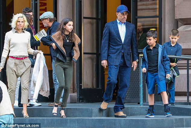 Speechless: Mrs. Seinfeld must have had some people puzzled when she put on a pair of baggy trousers for a family outing to see the play Hamilton on April 12 with Jerry and their kids Sascha, Julian and Shepherd