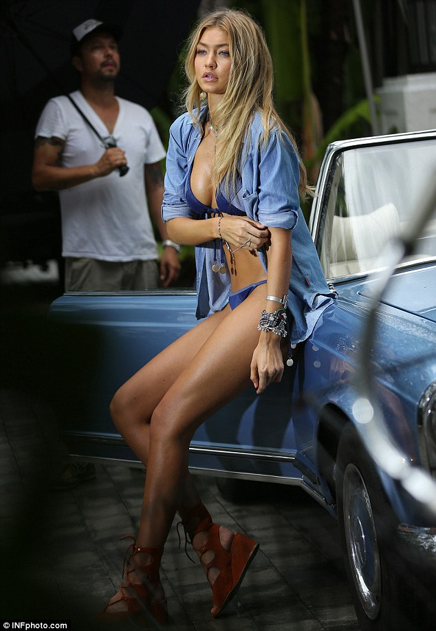 As if Miami wasn't hot enough already: Gigi had temperatures rising as she posed  against a blue convertible