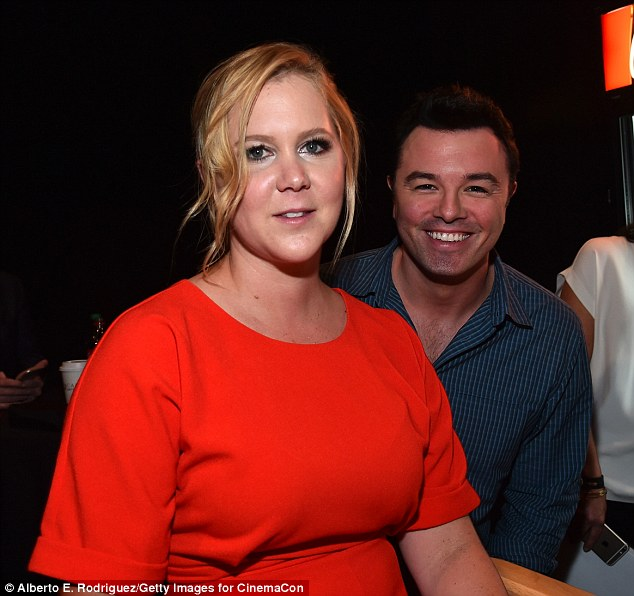 Amusing duo: Also posing with Amy backstage was Family Guy creator Seth MacFarlane, who was there to promote his stuffed bear sequel Ted 2