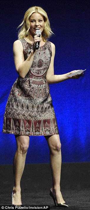 Shiny jumpsuit!Pitch Perfect 2 director Elizabeth Banks took home the Breakthrough Filmmaker award after donning two brown-tinged ensembles