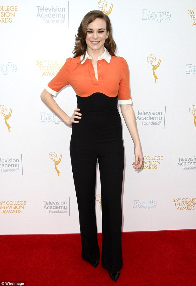 Orange you jealous? The Flash star Danielle Panabaker highlighted her willowy figure in an orange and black polo shirt with sleek black trousers