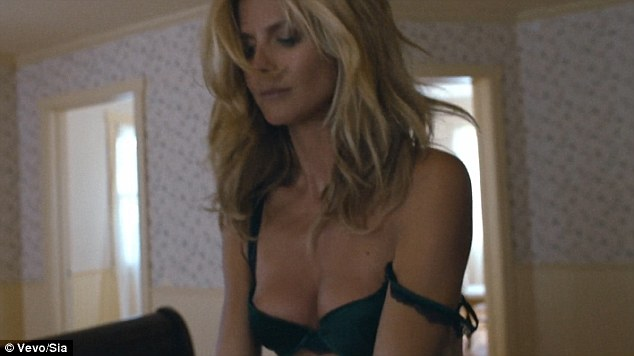 Heidi Klum, 41, looks incredible as she strips down to her underwear in new lingerie campaign to the sound of Sia's track Fire Meets Gasoline
