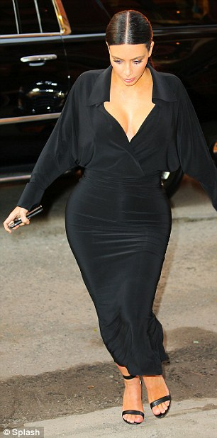 Beautiful in black: Following the announcement Kim was spotted showing off her stunning curves in a fitted black dress in New York City