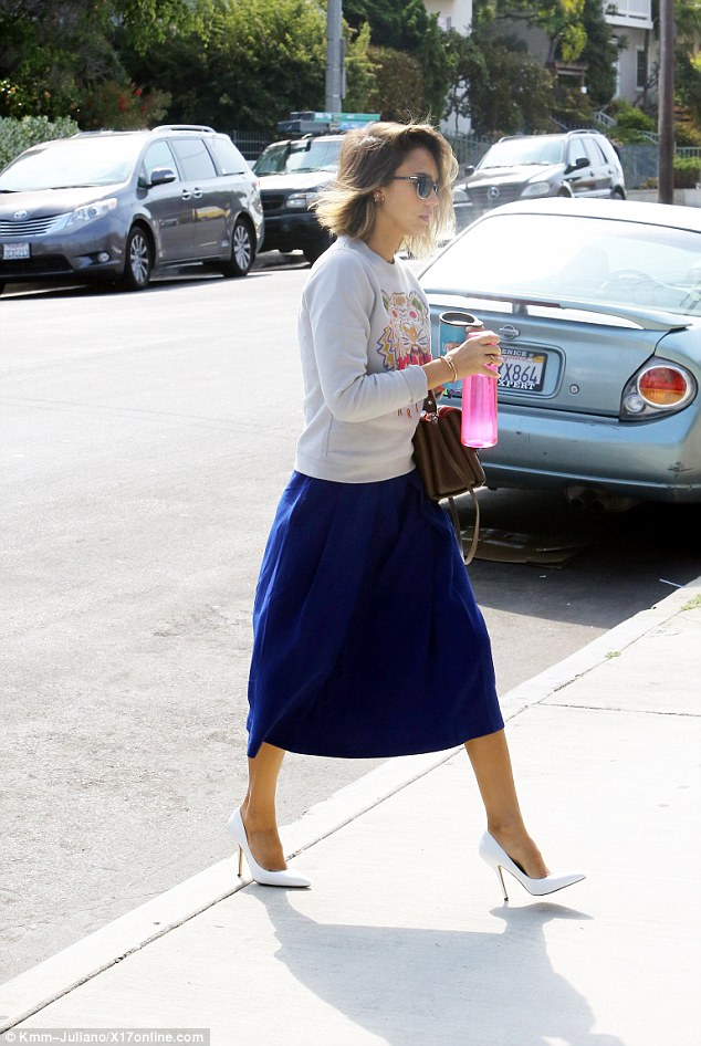 Classy on the coast: Jessica Alba, 33, spotted in a long spring skirt and tiger sweatshirt, matched with white pointy toe pumps at Venice Beach on Thursday