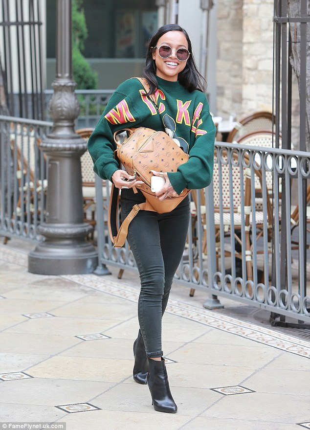 Happy: Karrueche Tranwas all smiles once again on Thursday as enjoyed some retail therapy in Los Angeles