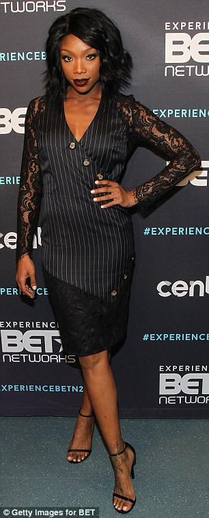 Wow factor: Brandy Norwood, left, took the lead in a racy lace and pin-striped black dress while Solange Knowles dared to impress in a multi-patterned number at the BET Upfronts in NYC on Thursday