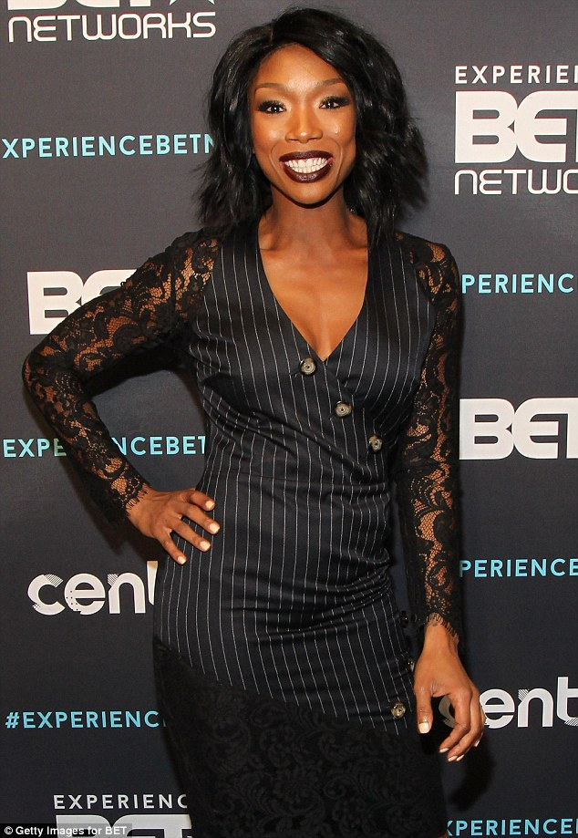Details: Brandy's dress was sophisticated and sexy with lace sleeves and more lace detailing the skirt
