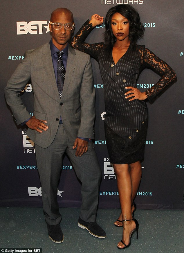 She's got the power: Brandy took time out to pose with BET President Of Programming Stephen G. Hill