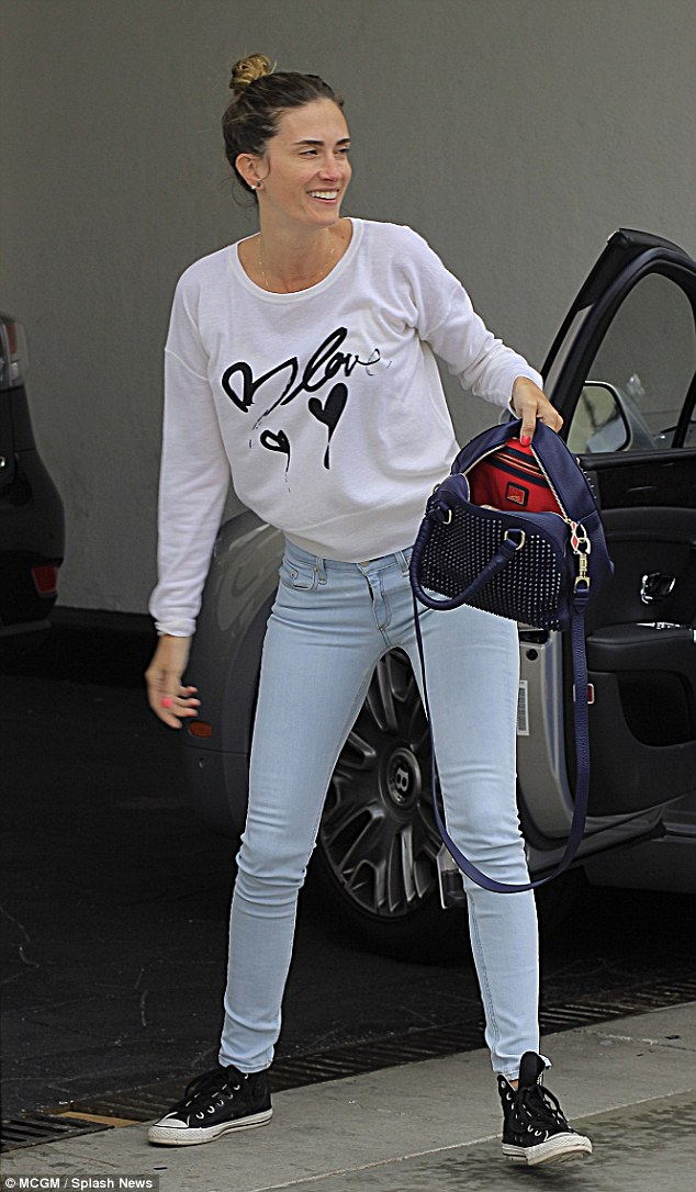 Beautiful: Mark's model wife Rhea Durham arrives for lunch make-up free and casually dressed in black high-tops