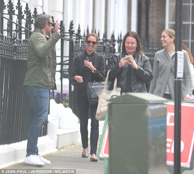 Sharing a giggle: Earlier in the day, the 46 year old was pictured laughing and joking with pals in central London ahead of her documentary launch