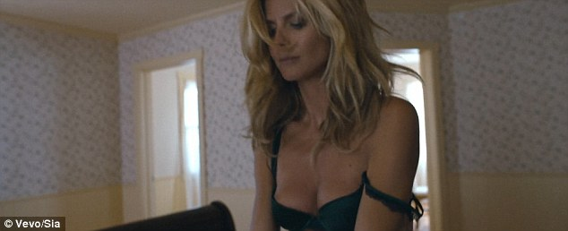 Racy: Heidi strips down to black lingerie from her own Intimates collection in the steamy clip