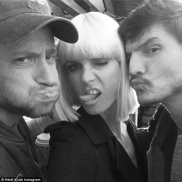 Playful: The star showed her playful side behind-the-scenes alongside photographer Francesco Carrozzini, left, and Pedro Pascal, right