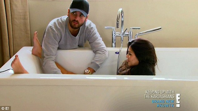 Hands on: Scott made sure his partner was ready for her close-up as he gave her 'downstairs' area a trim