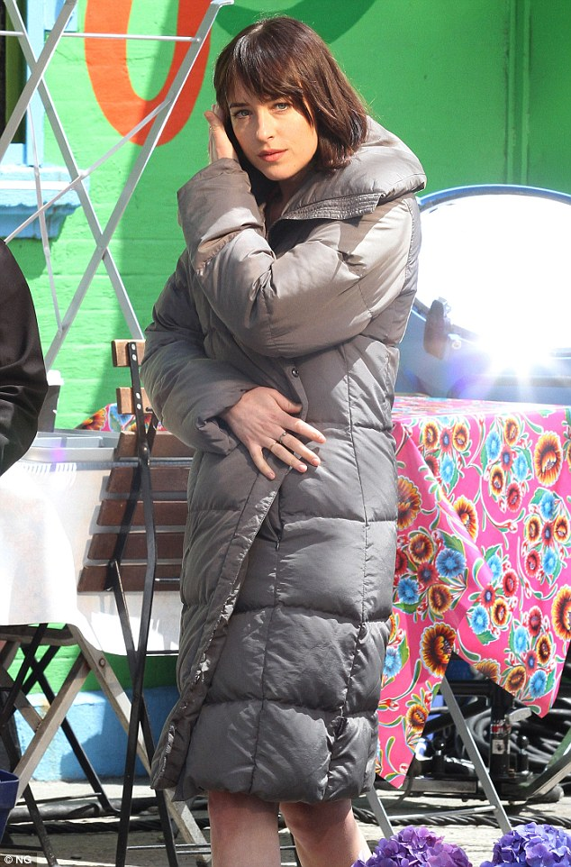 Keeping warm: At times the actress was spotted bundling up in a long, grey puffy jacket