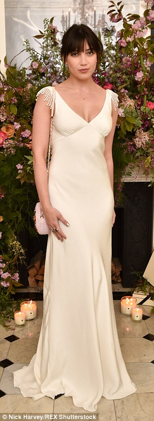 Stunning: The 25-year-old star cut an elegant figure in a low-cut dress with tasseled shoulder detailing