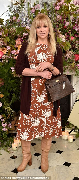 Rock 'n' roll: Jo Wood opted for dressed down florals in a brown frock and leather boots
