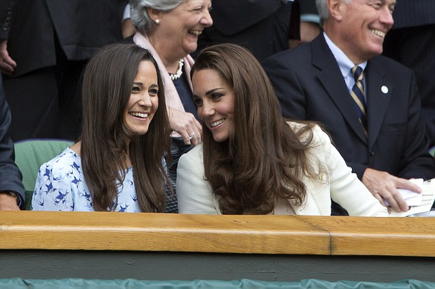 Friends: Pippa, pictured laughing at Wimbledon with her sister, could be godmother to Kate's second child