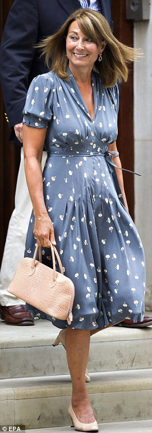Carole leaving St. Mary's hospital in after visiting the royal couple and their newborn baby boy, Prince George, in July 2013