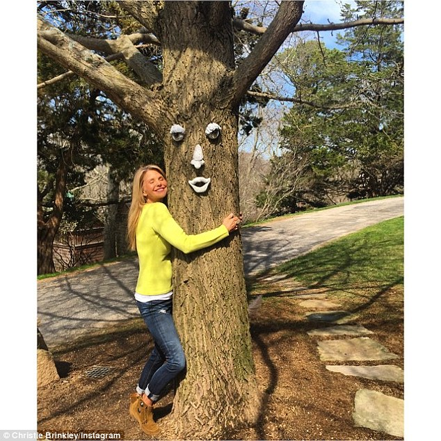 Squeeze: Uptown Girl Christie Brinkley also showed her support on Instagram for Earth Day, with an adorable tree-hugging snap