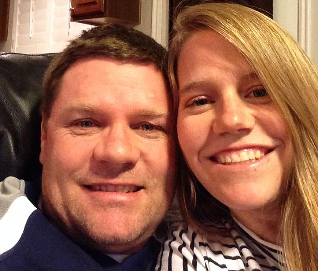 Nicole Mayhew (right) had rushed home after she got a strange feeling she needed to see her husband Scott (left) to find him trapped under the car