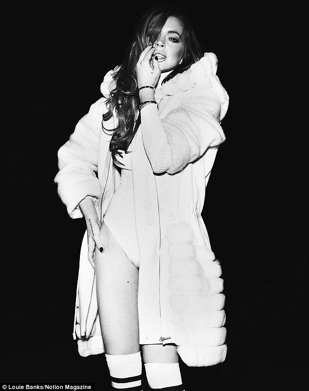 All white: The Hollywood star was wore the white fur coat over a white leotard in another photo