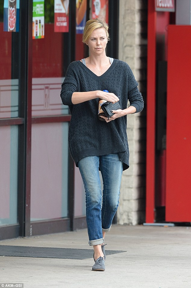 Keeping it real: The actress cut a casual figure in a baggy jumper and skinny jeans ahead of her Mad Max: Fury Road premiere later that evening