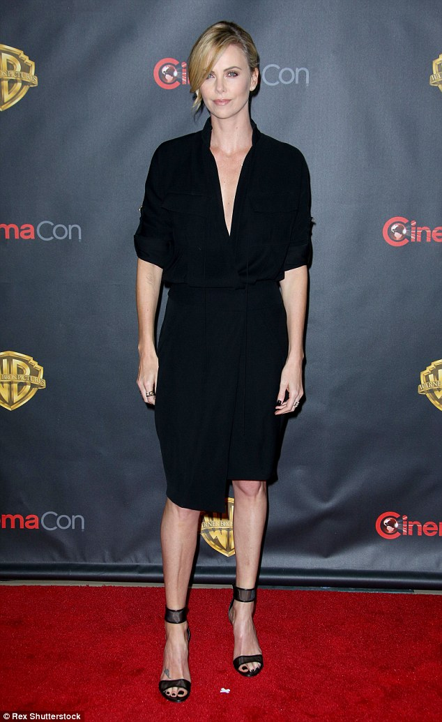 Back in black: Charlize Theron arrived at CinemaCon in Las Vegas later that evening