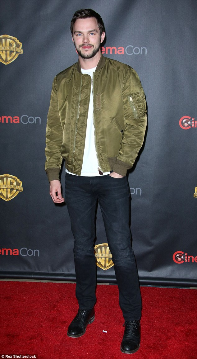 Handsome: Nicholas Hoult, 25, who recently split from Jennifer Lawrence, sported some facial hair and kept warm with a khaki bomber jacket