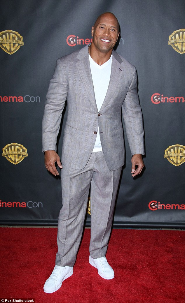 Bright: Dwayne 'The Rock' Johnson teamed his suit with white sneakers and a white t-shirt