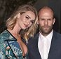"Rosie Huntington-Whiteley, left, and Jason Statham attend Burberry's ""London in Los Angeles"" event at the Griffith Observatory in Los Angeles, on Thursday, April 16, 2015. (Photo by Jordan Strauss/Invision/AP)"