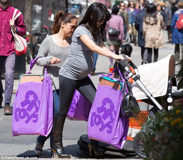 Shopping trip: The star made a stop at Babies 'R' Us/Toys 'R' Us