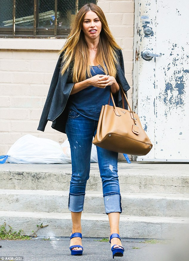 Keeping her chin up:Despite the recent troubles she's been facing from ex-fiance Nick Loeb, Sofia Vergara seemed to be in a playful mood when she stepped out in Beverly Hills on Wednesday to run errands