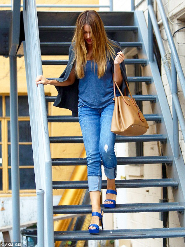 Effortlessly stylish: The actress wore a simple blue top and form-fitting three-quarter length jeans, which highlighted her long slim legs - but was noticeably missing her engagement ring