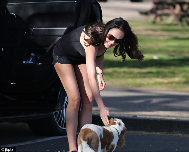 Caring: Tamara stopped to pet a dog before she and Sophia drove off