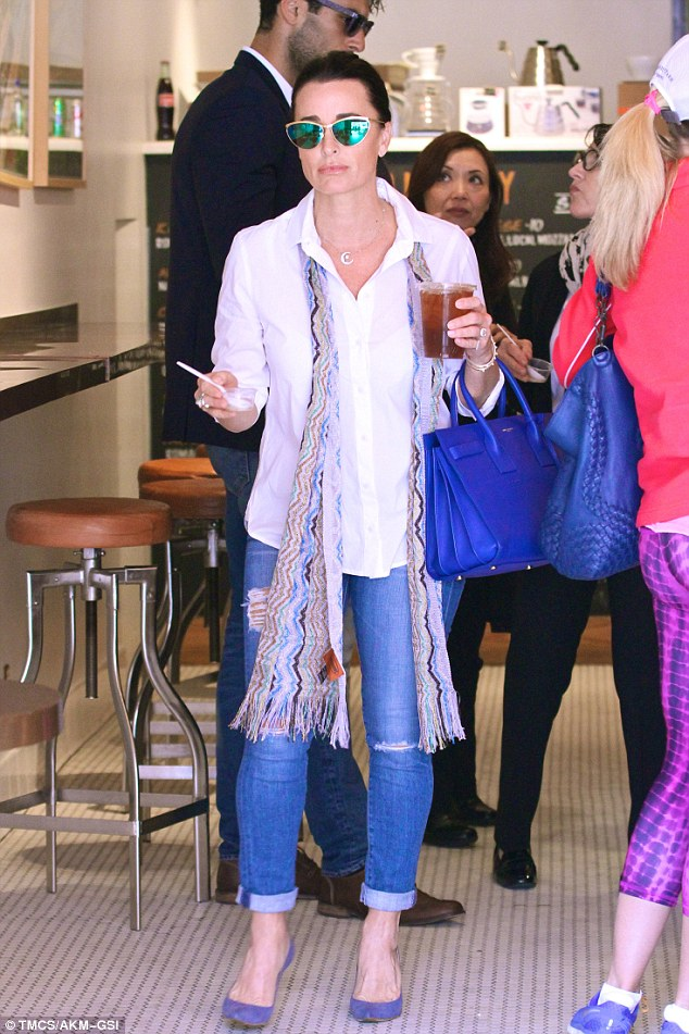 My lips are sealed: Kyle Richards, 46, was seen in Beverly Hills on Wednesday getting lunch with a friend and avoiding the subject of her sister Kim Richards, 50