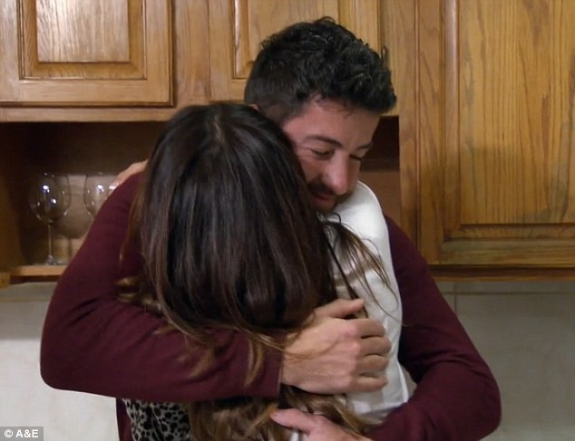 Hug it out: The newlyweds, who were excited about taking the next step together, embraced in their new kitchen