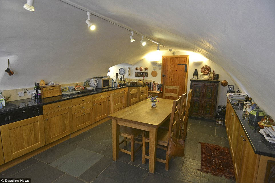 Barnholm Castle's great vault is now the luxury home's kitchen, which is big enough for a dining table and all modern appliances