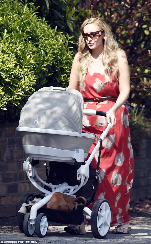 Baby's day out: Catherine Tyldesley enjoyed a walk around Bolton, Greater Manchester with her four-week-old son Alfie on Thursday afternoon