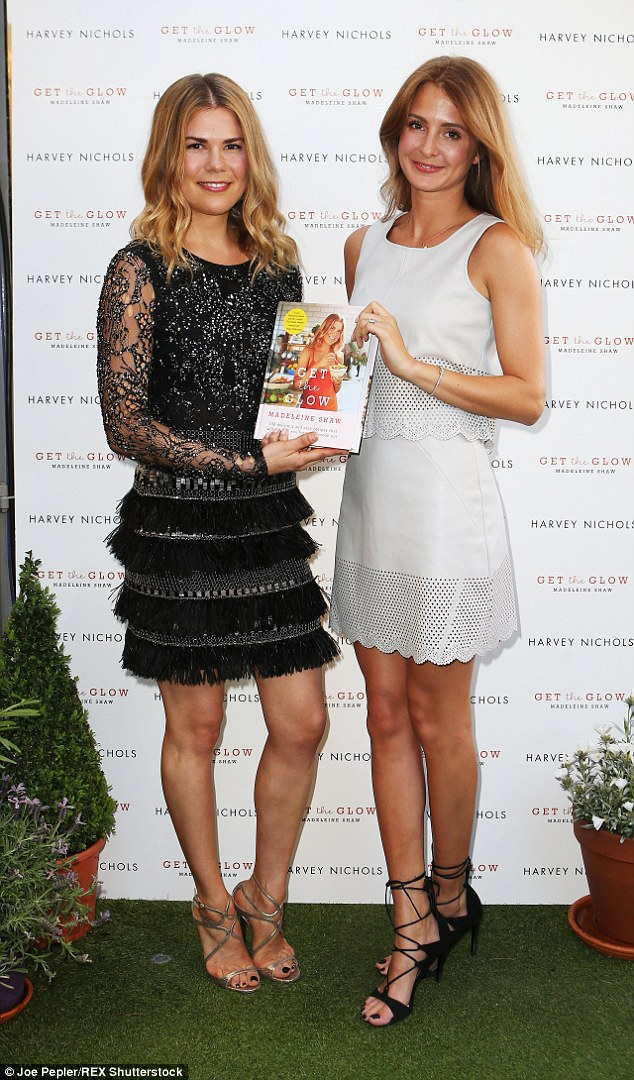 Proud pose: They showed off Madeleine's new book, Get The Glow, which is packed full of healthy eating tips
