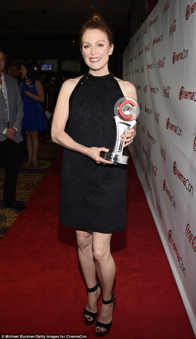 Triumphant! Moore later changed into a Givenchy halter cocktail dress to pick up the festival's Vanguard Award at the casino's OMNIA Nightclub