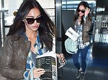 """New York, NY - A sultry Megan Fox dressed down as she arrived to JFK on Thursday afternoon, toting along a book about """"ancient aliens"""" for the flight. The 'TMNT' actress donned a plaid flannel, blue leggings and high tops sneakers, accessorizing with a Givenchy Nightingale bag as she made her way through the airport. \nAKM-GSI      April  23, 2015\nTo License These Photos, Please Contact :\nSteve Ginsburg\n(310) 505-8447\n(323) 423-9397\nsteve@akmgsi.com\nsales@akmgsi.com\nor\nMaria Buda\n(917) 242-1505\nmbuda@akmgsi.com\nginsburgspalyinc@gmail.com"""